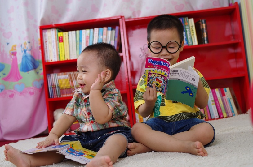 Two boys reading